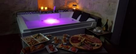 Day use in suite: Massaggio + idromassaggio da 50 min + aperitivo + camera per 4 ore